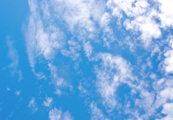 Gray and white clouds on blue sky in windy weather.