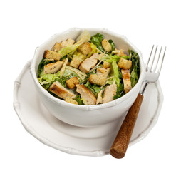 Caesar Salad with croutons on white background. Selective focus.