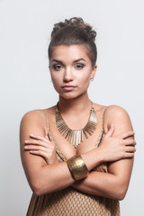 Young beautiful brunette woman with beads