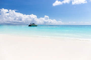 Beautiful crystal clear sea and white sand beach with boat at Tachai island, Andaman, Thailand
