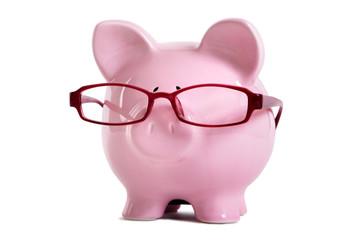 Pink piggy bank wearing glasses