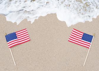 American flags on the sandy beach