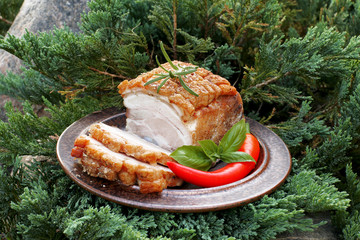 Cold baked pork with basil and pepper in juniper