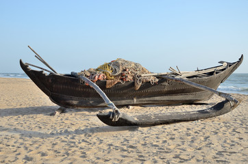 Traditional indian fishing boat at the beach of Kerala, India
