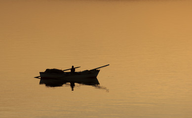 SUEZ CANAL/EGYPT - 3rd JANUARY 2007 - Silhouette of a lone fishe