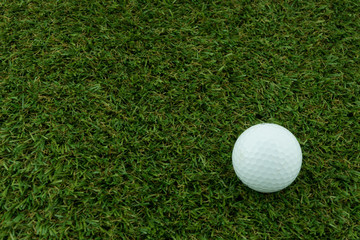 A golf ball on grass, Closeup shoot.