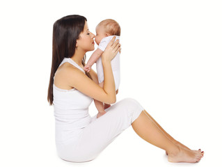 Portrait of happy young mother kissing cute baby