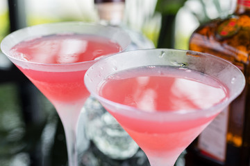 Two glasses with bright refreshing cocktail Cosmopolitan with