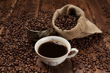 Cup of coffee and coffee grains