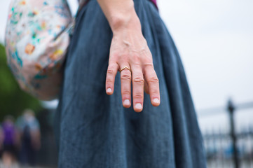 Young woman extending hand