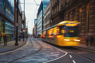 Yellow tram in Manchester, UK in the evening
