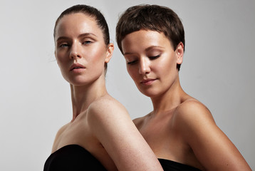 two young woman with a different skin type