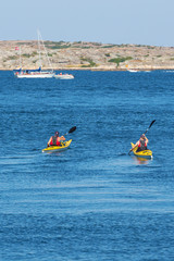 Kayakers on the sea in summer