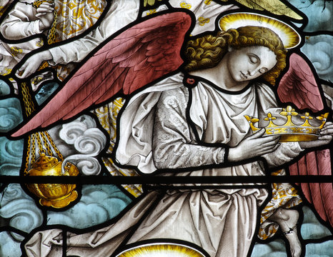 An angel with a crown in stained glass