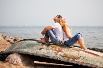 couple sitting on old boat