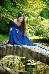 medieval princess on stone bridge