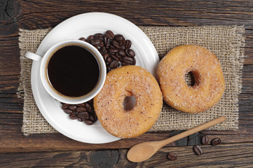 Coffee cup and donuts