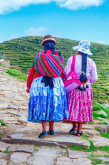 Bolivian  women in traditional clothes on the street
