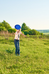 Girl playing frisbee in the park