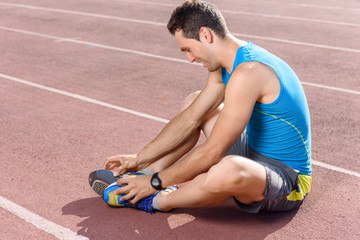 Man sitting and stretching his legs