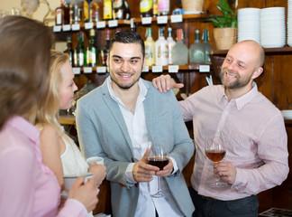 Young happy adults at bar