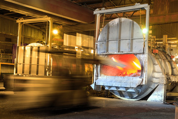 Loading aluminium in a furnace for recycling.