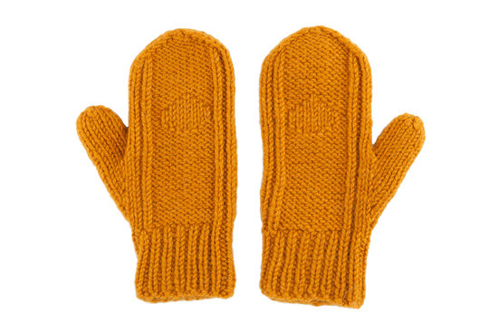 Yellow wool mittens on white