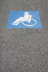 Symbol of the handicapped person painted on the asphalt