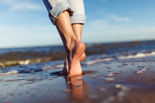 feet of woman  in the sea waves