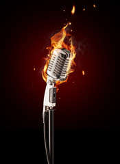 Retro singing microphone in fire