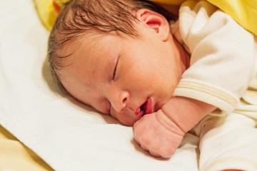 photo of a sleeping newborn baby closeup