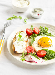 fried egg, vegetable salad and a grilled cheese sandwich