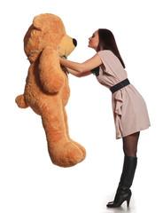 beautiful girl kissing toy bear