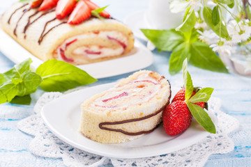 Homemade sponge roll with strawberries and mascarpone cream