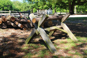 The old wooden sawhorse on the summer country farm scene
