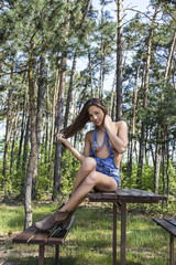 Beauty in the forest in denim mini shorts
