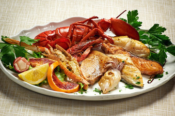 Mixed Grilled Fish with Lobster on White Plate