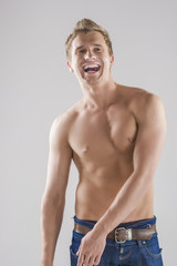 Portrait Of happy Smiling Caucasian Man Posing with Naked Torso