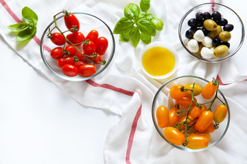 Sicilian red and yellow cherry tomatoes, green and black olives,