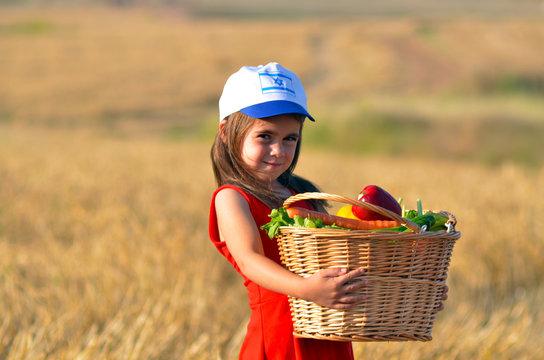 Jewish Israeli girl with fruit basket on Shavuot Jewish holiday