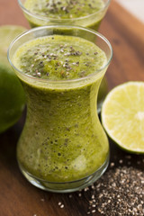 Healthy green fresh fruit and vegetable juice smoothie with chia