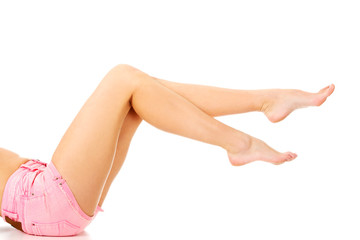 Slim woman legs in shorts.