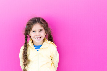 Little girl with long braids is smiling