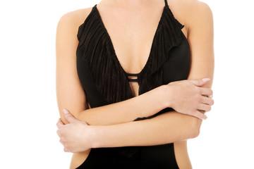 Woman's body in swimsuit.