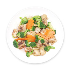 stir fried chicken with broccoli and carrot on plate isolated white background, top view