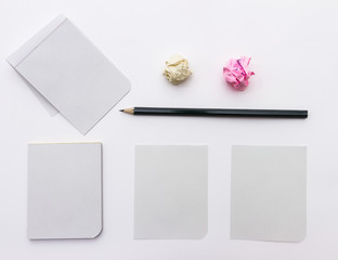 Close up of papers on white background.