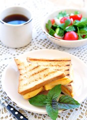 cheese sandwich with salad and coffee. breakfast