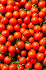 Red Cherry tomatoes in market close up, may use as background. .