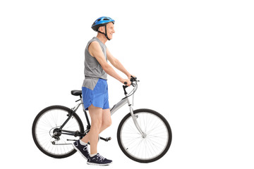 Active senior man pushing a bike