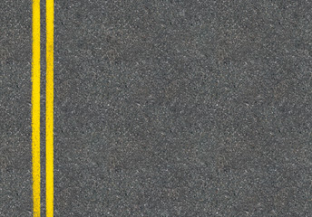 Asphalt road top view with two yellow lines Wall mural